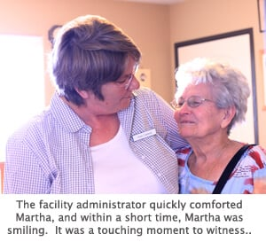 Facility administrator helping Martha