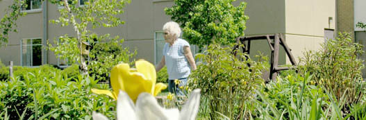 Chandler Place senior walking in garden