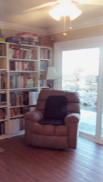 The interior of Comforts of home is comfortably furnished and has plenty of books and places to sit and enjoy life.