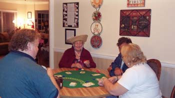 The residents in this photo enjoy activities and having fun in the common areas of this facility