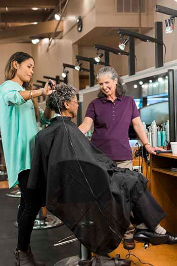 seniors getting hair done by caregiver
