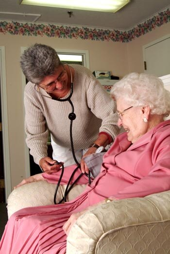 nurse helping a resident