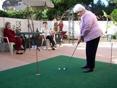 senior on a putting green
