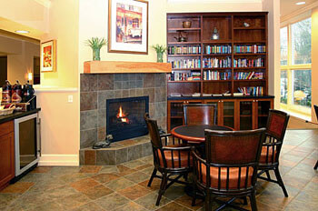 books, a fireplace and tables for the residents of this facility